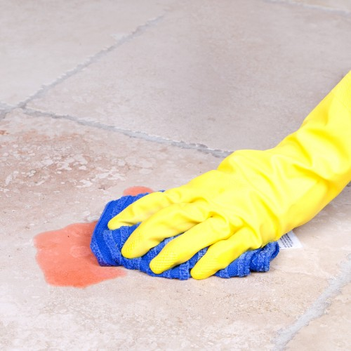 Mopping up spill on tile | Country Manor Decorating