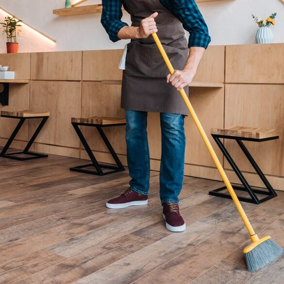 Sweeping hardwod floor | Country Manor Decorating